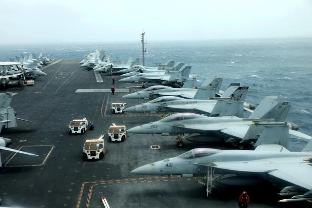 FILE PHOTO: F/A-18F aircrafts are seen on the deck of USS Abraham Lincoln in the Gulf of Oman near the Strait of Hormuz July 15, 2019. Picture taken July 15, 2019. REUTERS/Ahmed Jadallah/File Photo
