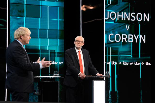Conservative leader Boris Johnson and Labour leader Jeremy Corbyn are seen during a televised debate ahead of general election in London, Britain, November 19, 2019. Jonathan Hordle/ITV/Handout via REUTERS