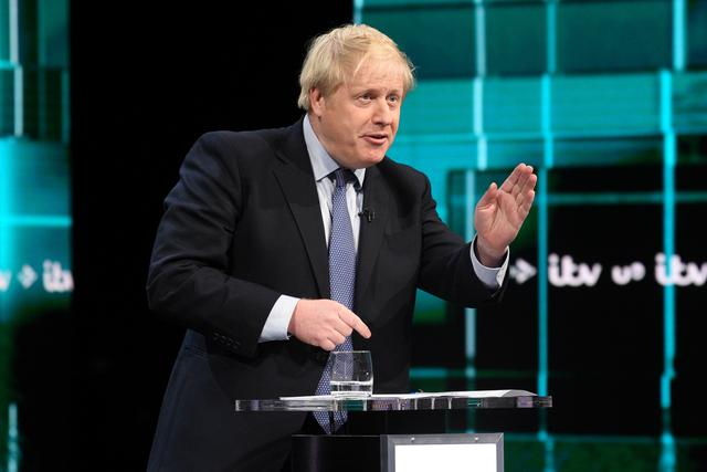 Conservative leader Boris Johnson speaks during a televised debate with Labour leader Jeremy Corbyn ahead of general election in London, Britain, November 19, 2019. Jonathan Hordle/ITV/Handout via REUTERS