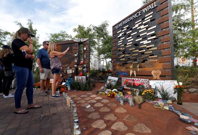 FILE PHOTO: People look at a Remembrance Wall at the Las Vegas Healing Garden during the one-year anniversary of the October 1 mass shooting in Las Vegas, Nevada, U.S. October 1, 2018.  REUTERS/Steve Marcus