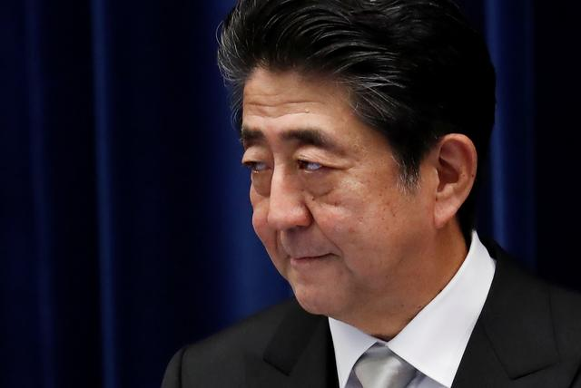 FILE PHOTO: Japan's Prime Minister Shinzo Abe attends a news conference after reshuffling his cabinet at his official residence in Tokyo, Japan September 11, 2019. REUTERS/Issei Kato/File Photo