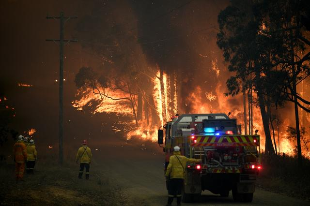 NSW Rural Fire Service crews fight a fire as it burns close to property on Wheelbarrow Ridge Road at Colo Heights, north west of Sydney, Australia, November 19, 2019. AAP Image/Dan Himbrechts/via REUTERS