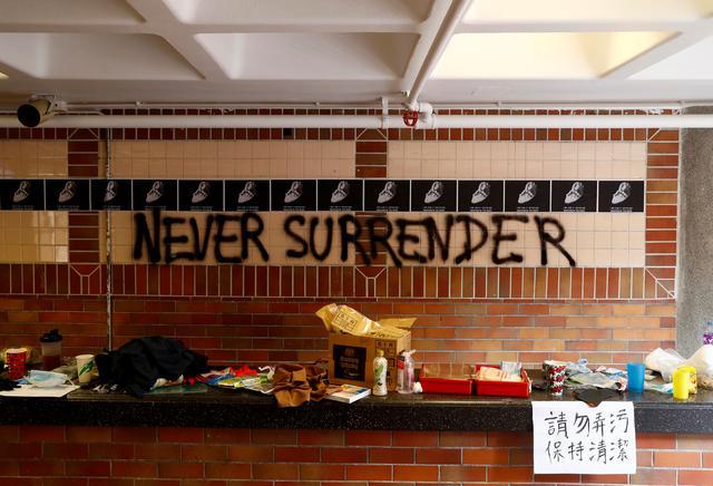 "The slogan ""Never Surrender"" is spray painted on a wall in the besieged Hong Kong Polytechnic University (PolyU) in Hong Kong, China, November, November 20, 2019. REUTERS/Thomas Peter"