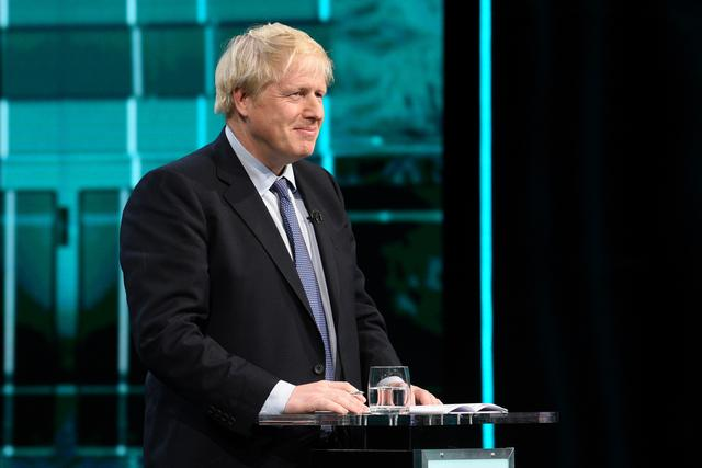 FILE PHOTO: Conservative leader Boris Johnson listens during a televised debate with Labour leader Jeremy Corbyn ahead of general election in London, Britain, November 19, 2019. Jonathan Hordle/ITV/Handout via REUTERS/File Photo