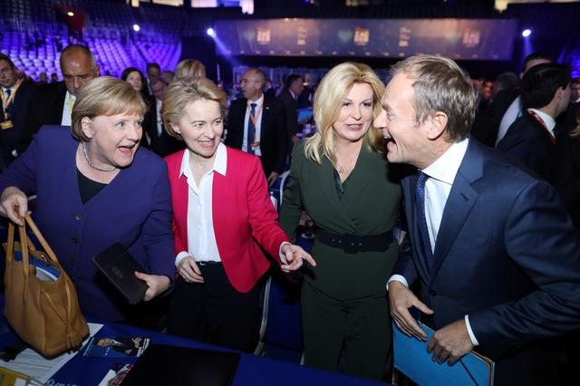 German Chancellor Angela Merkel, EU Commission President Ursula von der Leyen, Croatian President Kolinda Grabar Kitarovic with newly elected President of European People's Party Donald Tusk during the EPP congress in Arena Zagreb hall in Zagreb, Croatia November 20, 2019. REUTERS/Antonio Bronic