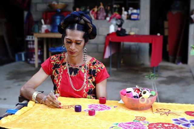 Estrella Vasquez, a muxe woman who features on the cover of Vogue magazine, paints a Huipil, a traditional garment used on the Isthmus of Tehuantepec, at her house in Juchitan, in Oaxaca state, Mexico November 19, 2019. Muxes are a third gender population traditional to Zapotec indigenous culture in southern Mexico. REUTERS/Jose de Jesus Cortes