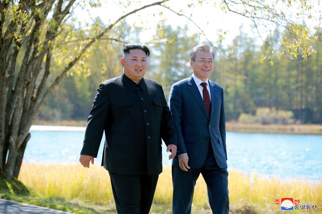 FILE PHOTO: South Korean President Moon Jae-in and North Korean leader Kim Jong Un walk during a luncheon, in this photo released by North Korea's Korean Central News Agency (KCNA) on September 21, 2018. KCNA via REUTERS/File Photo