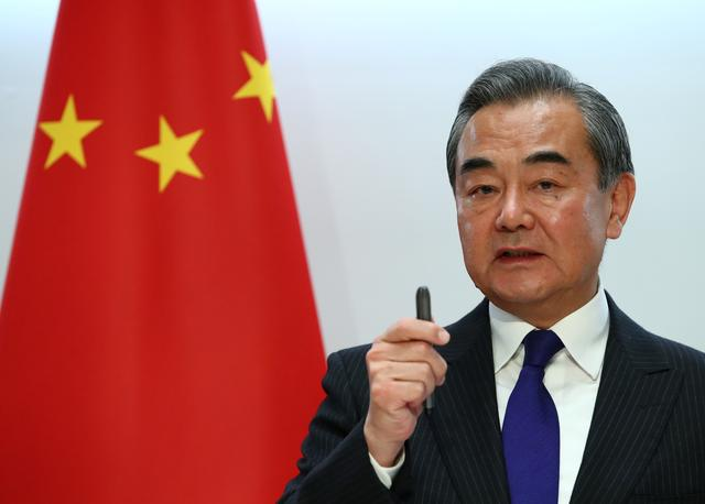 FILE PHOTO: Chinese Foreign Minister Wang Yi attends a news conference after a meeting with Swiss Foreign Minister Ignazio Cassis in Bern, Switzerland, October 22, 2019. REUTERS/Denis Balibouse/File Photo