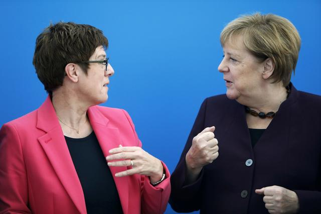 FILE PHOTO: Germany's Defence Minister and CDU Chairwoman Annegret Kramp-Karrenbauer and Chancellor Angela Merkel attend a CDU board meeting in Berlin, Germany, October 14, 2019.   REUTERS/Michele Tantussi/File Photo