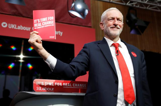 Leader of the Labour Party Jeremy Corbyn holds his party's manifesto during its launch in Birmingham, Britain November 21, 2019. REUTERS/Phil Noble
