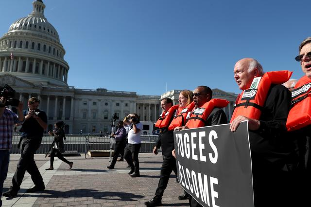 FILE PHOTO: People protest against planned Trump administration cuts to the U.S. refugee resettlement program, in front of the U.S. Capitol Building in Washington, U.S., October 15, 2019. REUTERS/Leah Millis/File Photo