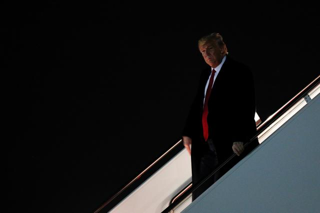 FILE PHOTO: U.S. President Donald Trump disembark from Air Force One at Joint Base Andrews in Maryland, U.S., November 20, 2019. REUTERS/Tom Brenner
