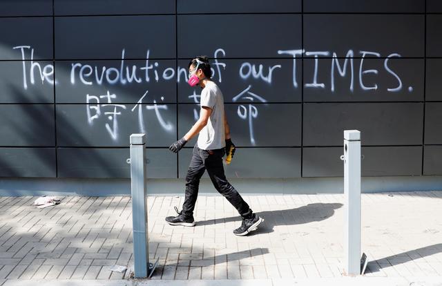FILE PHOTO: A protester walks inside the besieged Hong Kong Polytechnic University (PolyU) in Hong Kong, China, November 20, 2019. REUTERS/Adnan Abidi/File Photo