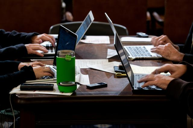 FILE PHOTO: Reporters type during a House Intelligence Committee impeachment inquiry hearing with Laura Cooper, deputy assistant secretary of defense for Russia, Ukraine and Eurasia, and David Hale, undersecretary of state for political affairs, on Capitol Hill in Washington, DC on November 20, 2019. Erin Schaff/Pool via REUTERS