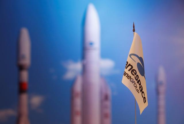 FILE PHOTO: A flag with a company logo is seen during satellite launch company Arianespace annual news conference in Paris, France, January 9, 2018.  REUTERS/Christian Hartmann/File Photo
