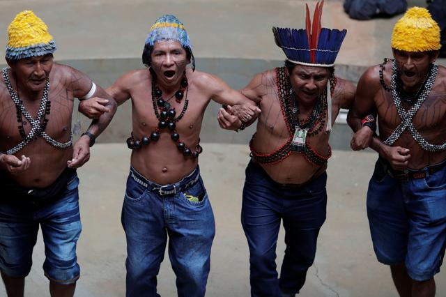 Indigenous people of the Munduruku tribe dance during a press conference to ask authorities for protection for indigenous land and cultural rights in Brasilia, Brazil November 21, 2019. REUTERS/Ueslei Marcelino