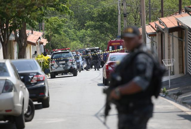 FILE PHOTO: A police officer is seen near a site where an armed gang holds people hostage after they robbed a securities company at the Viracopos airpoart freight terminal, in Campinas near Sao Paulo, Brazil October 17, 2019. REUTERS/Rahel Patrasso/File Photo