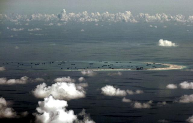 FILE PHOTO: An aerial photo taken though a glass window of a Philippine military plane shows the alleged on-going land reclamation by China on mischief reef in the Spratly Islands in the South China Sea, west of Palawan, Philippines, May 11, 2015.  REUTERS/Ritchie B. Tongo/Pool