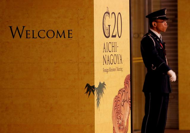 FILE PHOTO: A guard stands in front of an entrance of the venue of G20 Foreign Ministers meeting in Nagoya, Japan, November 21, 2019. REUTERS/Kim Kyung-Hoon