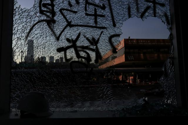 Shattered glass is seen at Hong Kong Polytechnic University (PolyU), in Hong Kong, China November 22, 2019. REUTERS/Leah Millis