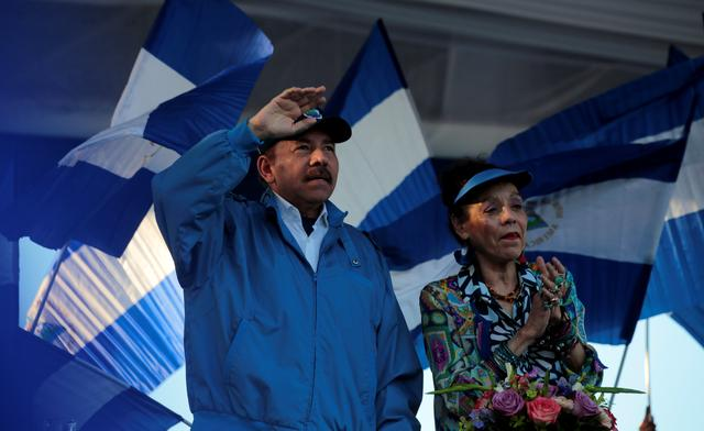 "Nicaraguan President Daniel Ortega and Vice President Rosario Murillo gesture during a march called ""We walk for peace and life. Justice"" in Managua, Nicaragua, September 5, 2018. REUTERS/Oswaldo Rivas"