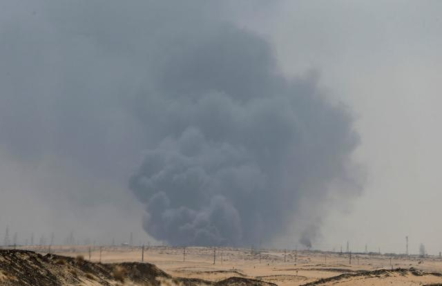 FILE PHOTO: Smoke is seen following a fire at Aramco facility in the eastern city of Abqaiq, Saudi Arabia, September 14, 2019. REUTERS/Stringer/