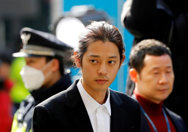 FILE PHOTO: South Korean singer Jung Joon-young arrives for questioning on accusations of illicitly taping and sharing sex videos on social media, at the Seoul Metropolitan Police Agency in Seoul, South Korea, March 14, 2019.   REUTERS/Kim Hong-Ji