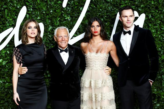 Barbara Palvin, Giorgio Armani, Sara Sampaio and Nicholas Hoult pose as they arrive at the Fashion Awards 2019 in London, Britain December 2, 2019. REUTERS/Lisi Niesner