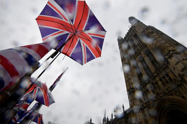 FILE PHOTO: Union Jack flags are seen outside the Houses of Parliament in London, Britain, October 24, 2019. REUTERS/Toby Melville