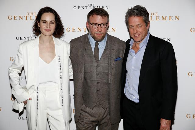 "Director Guy Ritchie and actors Michelle Dockery and Hugh Grant pose as they arrive for a special screening of ""The Gentlemen"" in London, Britain December 3, 2019. REUTERS/Henry Nicholls"