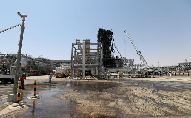 FILE PHOTO: Workers are seen at the damaged site of Saudi Aramco oil facility in Khurais, Saudi Arabia, September 20, 2019. REUTERS/Hamad l Mohammed//File Photo