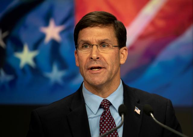 FILE PHOTO: U.S. Defense Secretary Mark T. Esper delivers remarks before ringing the closing NASDAQ bell for Veterans Day in New York, New York, November 11, 2019. DoD/Lisa Ferdinando/Handout via REUTERS/File Photo