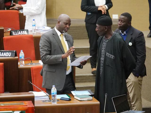 FILE PHOTO: The Gambia Justice Minister Abubacarr Tambadou discusses the bill with a member of Parliament at the national assembly in  Banjul, Gambia December 2, 2019. REUTERS/Christophe Van Der Perre