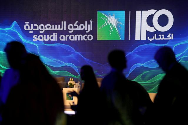 FILE PHOTO: A sign of Saudi Aramco's initial public offering (IPO) is seen during a news conference by the state oil company at the Plaza Conference Center in Dhahran, Saudi Arabia November 3, 2019. REUTERS/Hamad I Mohammed/File Photo
