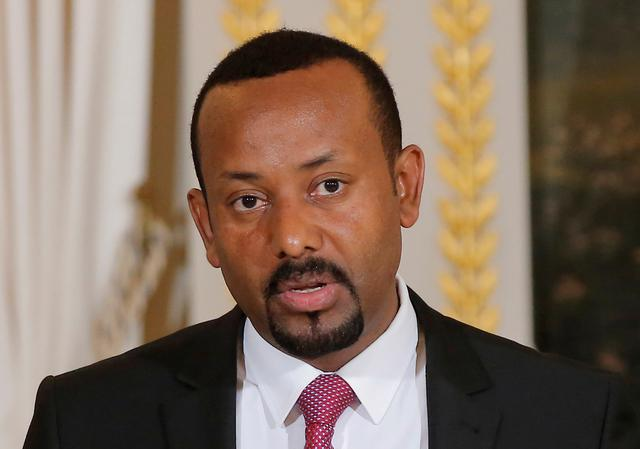 FILE PHOTO: Ethiopian Prime Minister Abiy Ahmed speaks during a media conference at the Elysee Palace in Paris, France, October 29, 2018. Michel Euler/Pool via REUTERS/File Photo