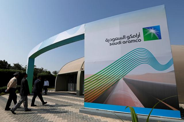 FILE PHOTO: The logo of Aramco is seen as security personnel walk before the start of a press conference by Aramco at the Plaza Conference Center in Dhahran, Saudi Arabia November 3, 2019. REUTERS/Hamad I Mohammed