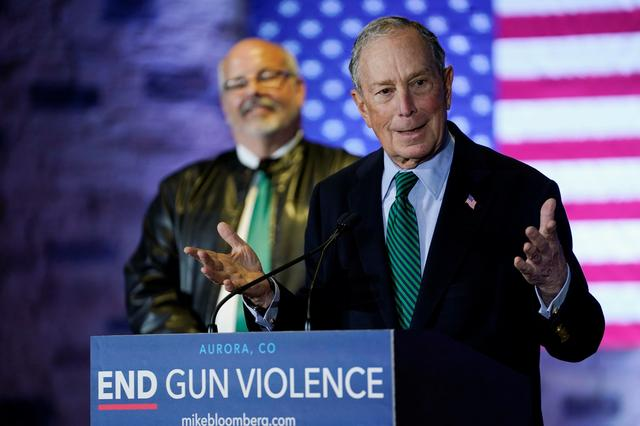 Democratic U.S. presidential candidate Michael Bloomberg speaks about his gun policy agenda as Tom Sullivan, whose son was killed in the 2012 Aurora theater shooting, stands behind in Aurora, Colorado, U.S. December 5, 2019. REUTERS/Rick Wilking
