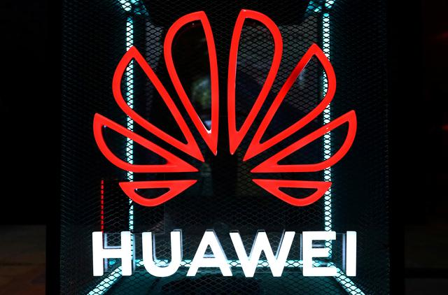 FILE PHOTO: The Huawei logo is pictured at the IFA consumer tech fair in Berlin, Germany, September 5, 2019. REUTERS/Hannibal Hanschke