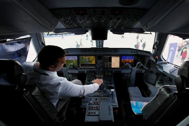 FILE PHOTO: A pilot sits in a cockpit of the Embraer E-195 E2 jet airliner at the MAKS 2019 air show in Zhukovsky, outside Moscow, Russia, August 27, 2019.  REUTERS/Maxim Shemetov/File Photo