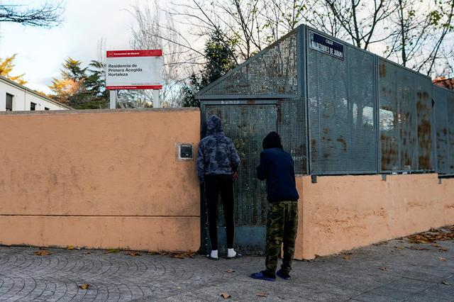 Two young people wait to enter at minors' reception center in the Hortaleza district in Madrid, Spain, December 5, 2019. REUTERS/Juan Medina