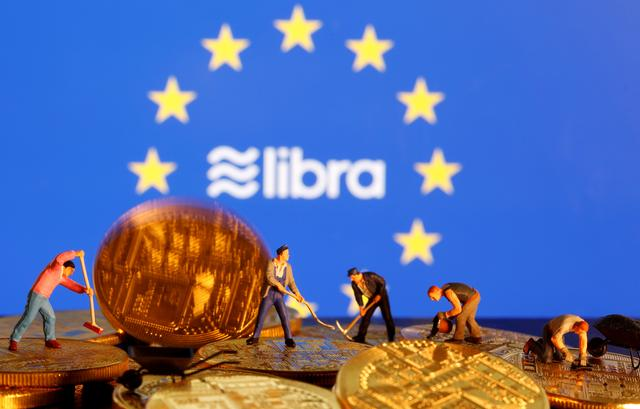 FILE PHOTO: Small toy figures are seen on representations of the virtual currency before the displayed European Union flag and the Facebook Libra logo in this illustration picture, October 20, 2019. REUTERS/Dado Ruvic/Illustration -/File Photo