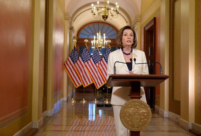 U.S. House Speaker Nancy Pelosi (D-CA) delivers remarks on the status of the House impeachment inquiry into U.S. President Donald Trump on Capitol Hill in Washington, U.S., December 5, 2019. REUTERS/Erin Scott
