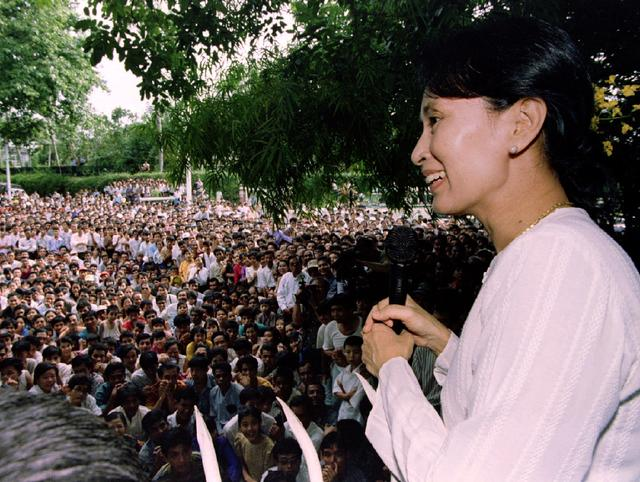FILE PHOTO: Freed pro-democracry leader Aung San Suu Kyi smiles while speaking to hundreds of supporters from the gate at her residential compound in Yangon, Myanmar July 19, 1995.  REUTERS/Luis D'Orey