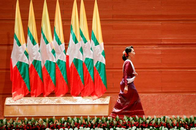 FILE PHOTO: Myanmar State Counselor Aung San Suu Kyi walks off the stage after delivering a speech to the nation on the Rakhine and Rohingya situation, in Naypyitaw, Myanmar September 19, 2017. REUTERS/Soe Zeya Tun/File Photo