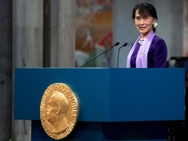 FILE PHOTO: Myanmar opposition leader Aung San Suu Kyi delivers her Nobel acceptance speech during a ceremony at Oslo's City Hall, Norway June 16, 2012.  Daniel Sannum Lauten/Pool via REUTERS/File Photo