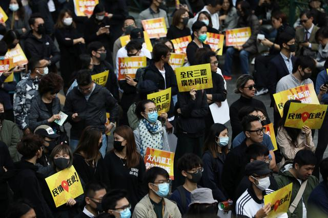 FILE PHOTO: Anti-government demonstrators gather for a lunchtime protest at Chater Garden in Hong Kong, China, December 2, 2019. REUTERS/Leah Millis
