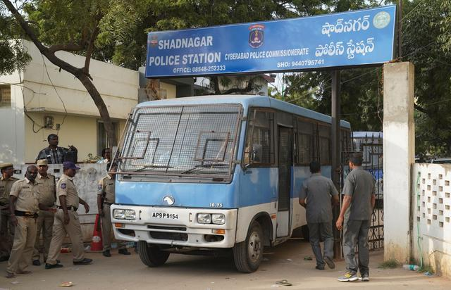 FILE PHOTO: A police van carrying four men accused of the alleged rape and murder of a 27-year-old woman, leaves a police station in Shadnagar, on the outskirts of Hyderabad, India, November 30, 2019. REUTERS/Vinod Babu