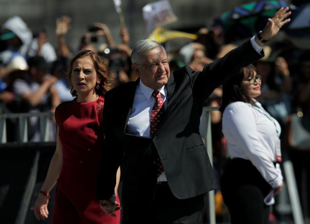 FILE PHOTO: Mexican President Andres Manuel Lopez Obrador, accompanied by his wife, Beatriz Gutierrez Muller, attends the anniversary of his first year in office at the Zocalo Square in Mexico City, Mexico, December 1, 2019. REUTERS/Daniel Becerril