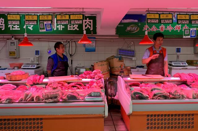 FILE PHOTO: Pork vendors' stalls at a market in Beijing, China, November 11, 2019.  REUTERS/Fang Nanlin