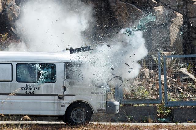 Fifty grams of high explosives detonate inside a van at the explosive ordnance disposal (EOD) depot of the Hong Kong police during a media tour in Hong Kong, China, December 6, 2019.  REUTERS/Thomas Peter